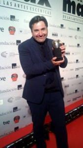 Sam Slade, con el Premio Max